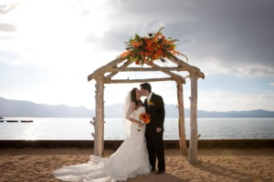 Lake tahoe beach wedding couple