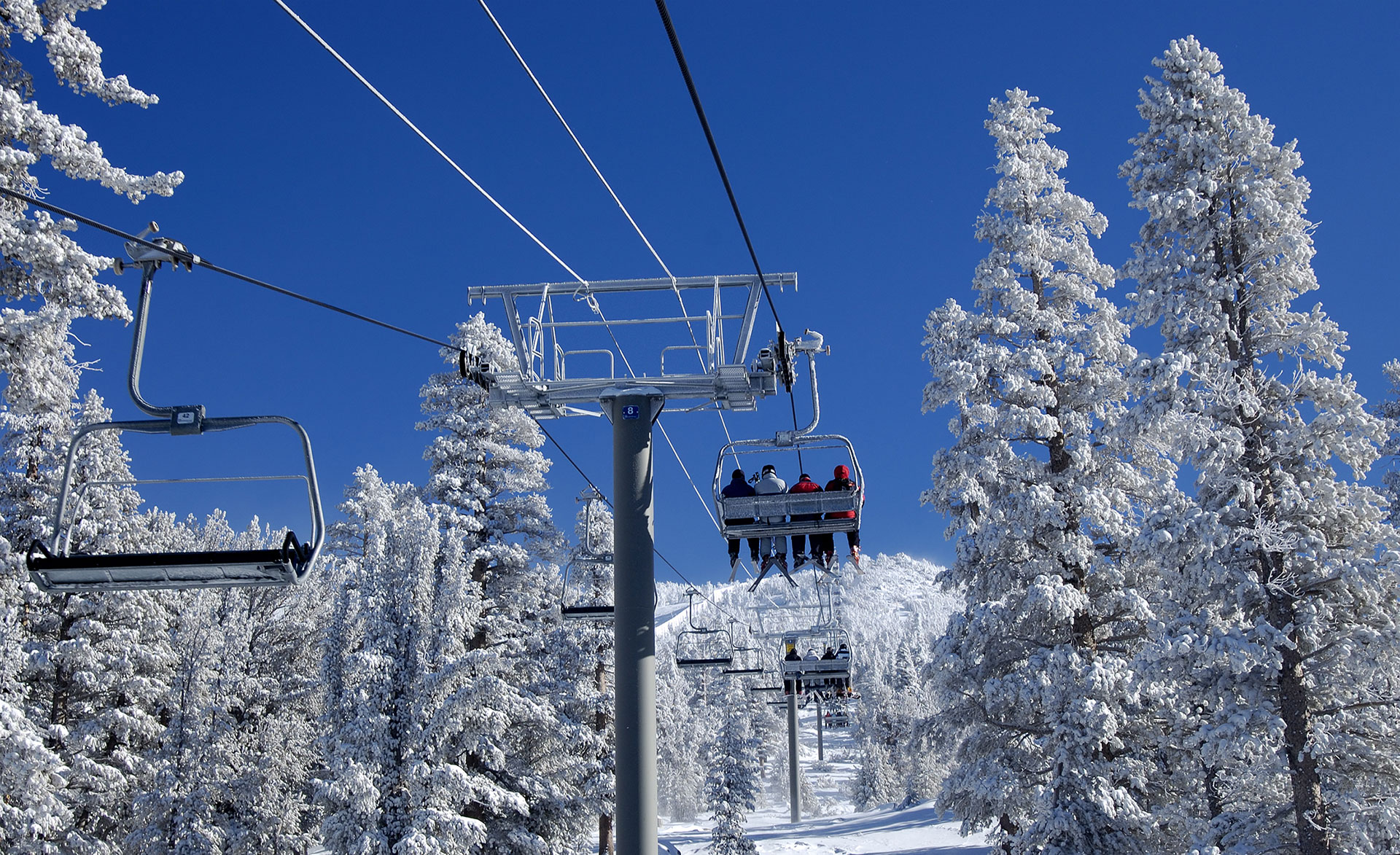 Take the ski lift to the top of the mountain and get ready to enjoy an epic skiing adventure.