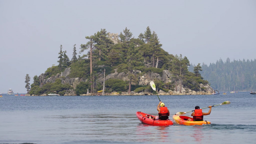 Kayakers visit island area near Emerald Bay