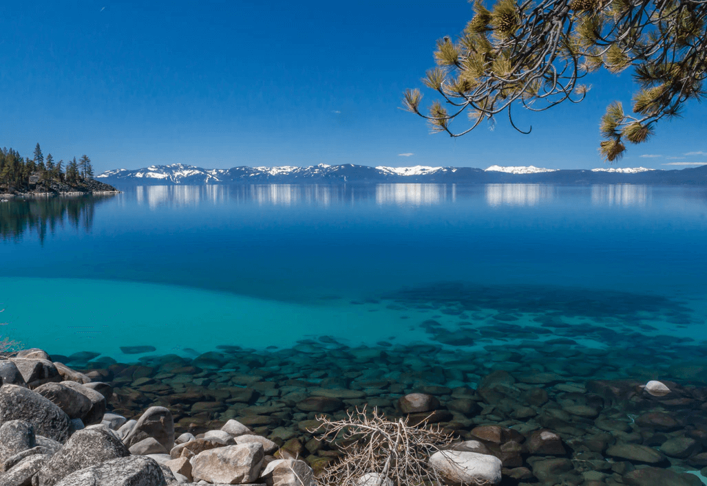 Blue Lake Tahoe waters with Mountain view